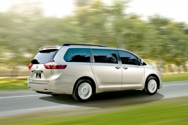 Driving 2017 Toyota Sienna Limited AWD in Creme Brulee Mica from a rear right three-quarter view