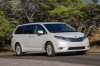 Driving 2017 Toyota Sienna Limited in Super White from a front right three-quarter view