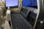 Picture of 2010 Toyota Tacoma Double Cab Rear Seats Folded in Sand Beige