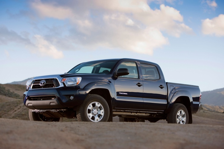 2015 Toyota Tacoma Double Cab SR5 V6 4WD in Blue Ribbon Metallic from a front left three-quarter view