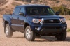 Driving 2015 Toyota Tacoma Double Cab SR5 V6 4WD in Blue Ribbon Metallic from a front right view