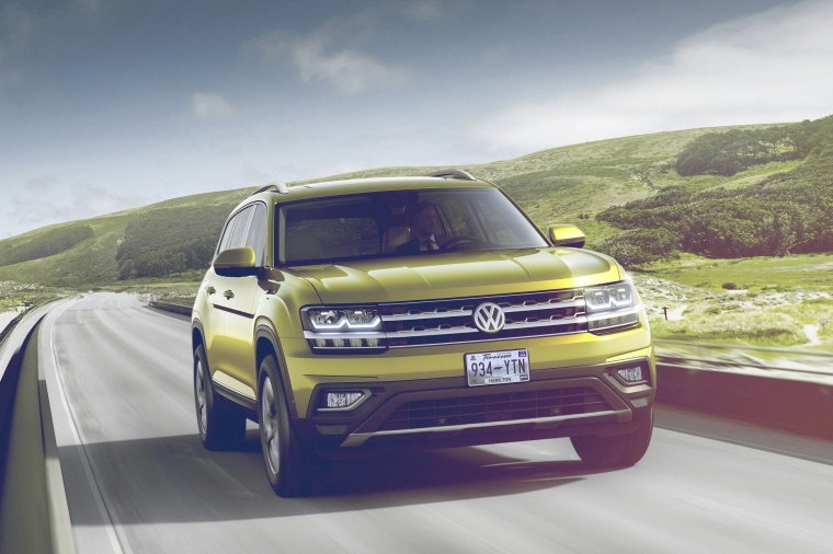 Driving 2018 Volkswagen Atlas V6 SEL in Kurkuma Yellow Metallic from a front right view
