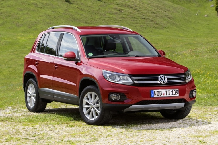2012 Volkswagen Tiguan in Wild Cherry Metallic from a front right view