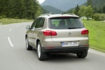 2012 Volkswagen Tiguan in White Gold Metallic - Driving Rear View