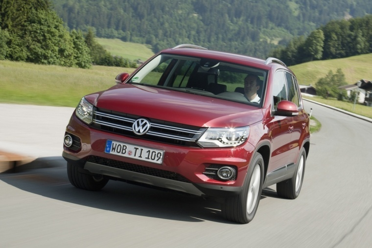 Driving 2016 Volkswagen Tiguan in Wild Cherry Metallic from a front left view