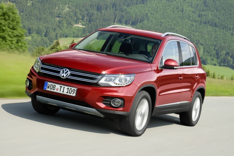 Driving 2016 Volkswagen Tiguan in Wild Cherry Metallic from a front left three-quarter view