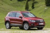 2016 Volkswagen Tiguan in Wild Cherry Metallic from a front right three-quarter view
