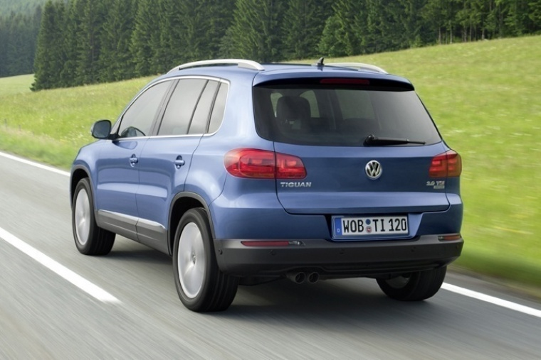 Driving 2017 Volkswagen Tiguan from a rear left view