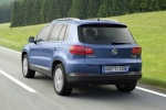 Picture of a driving 2017 Volkswagen Tiguan from a rear left perspective