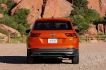 Picture of a 2018 Volkswagen Tiguan SEL in Habanero Orange Metallic from a rear perspective