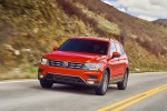 Picture of a driving 2018 Volkswagen Tiguan SEL in Habanero Orange Metallic from a front left perspective