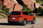 Picture of a 2018 Volkswagen Tiguan SEL in Habanero Orange Metallic from a rear right perspective