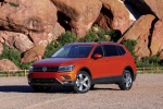 Picture of a 2018 Volkswagen Tiguan SEL in Habanero Orange Metallic from a front left three-quarter perspective