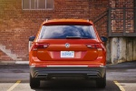Picture of a 2018 Volkswagen Tiguan SE in Habanero Orange Metallic from a rear perspective