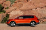 Picture of a 2018 Volkswagen Tiguan SEL in Habanero Orange Metallic from a left side perspective