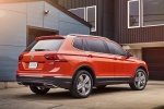 Picture of a 2018 Volkswagen Tiguan SEL in Habanero Orange Metallic from a rear right three-quarter perspective