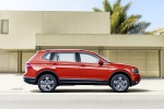 Picture of a 2019 Volkswagen Tiguan SEL in Habanero Orange Metallic from a side perspective