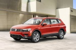 Picture of a 2019 Volkswagen Tiguan SEL in Habanero Orange Metallic from a front left three-quarter perspective