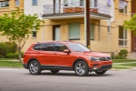 Picture of a driving 2019 Volkswagen Tiguan SEL in Habanero Orange Metallic from a rear right three-quarter perspective
