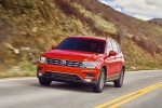 Picture of a driving 2019 Volkswagen Tiguan SEL in Habanero Orange Metallic from a front left perspective