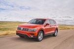 Picture of a driving 2019 Volkswagen Tiguan SEL in Habanero Orange Metallic from a front left three-quarter perspective