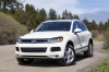 2011 Volkswagen Touareg TDI in Campanella White from a front left view