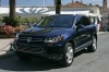 2014 Volkswagen Touareg Hybrid in Night Blue Metallic from a front left three-quarter view