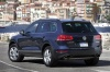 2014 Volkswagen Touareg Hybrid in Night Blue Metallic from a rear left three-quarter view
