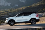 Picture of a driving 2019 Volvo XC40 T5 R-Design AWD in Crystal White Metallic from a left side perspective