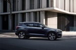 Picture of a driving 2019 Volvo XC40 T5 Inscription AWD in Denim Blue Metallic from a side perspective