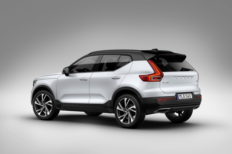 2020 Volvo XC40 T5 R-Design AWD in Crystal White Metallic from a rear left three-quarter view