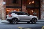 Picture of a driving 2020 Volvo XC40 T5 R-Design AWD in Crystal White Metallic from a right side perspective