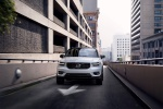 Picture of a driving 2020 Volvo XC40 T5 R-Design AWD in Crystal White Metallic from a frontal perspective