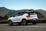 Picture of a driving 2020 Volvo XC40 T5 R-Design AWD in Crystal White Metallic from a rear left three-quarter perspective