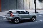 Picture of a driving 2020 Volvo XC40 T5 Momentum AWD in Light Blue from a rear right three-quarter top perspective