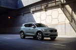 Picture of a driving 2020 Volvo XC40 T5 Momentum AWD in Light Blue from a front right three-quarter perspective