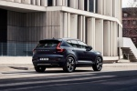 Picture of a driving 2020 Volvo XC40 T5 Inscription AWD in Denim Blue Metallic from a rear right three-quarter perspective