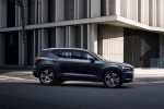 Picture of a driving 2020 Volvo XC40 T5 Inscription AWD in Denim Blue Metallic from a side perspective