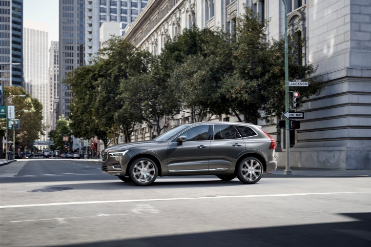 Picture of a driving 2019 Volvo XC60 T6 AWD in Pine Gray Metallic from a left side perspective