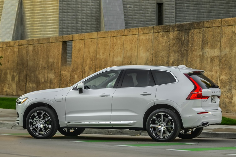 Picture of a 2019 Volvo XC60 T8 eAWD in Crystal White Pearl Metallic from a rear left three-quarter perspective