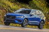 Picture of a driving 2019 Volvo XC60 T6 AWD in Bursting Blue Metallic from a front left three-quarter perspective