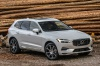 Picture of a 2019 Volvo XC60 T8 eAWD in Crystal White Pearl Metallic from a front right perspective