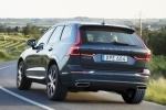 Picture of a driving 2019 Volvo XC60 T6 AWD in Denim Blue Metallic from a rear left perspective