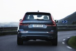 Picture of a driving 2019 Volvo XC60 T6 AWD in Denim Blue Metallic from a rear perspective