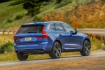 Picture of a driving 2019 Volvo XC60 T6 AWD in Bursting Blue Metallic from a rear right perspective