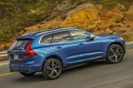 Picture of a driving 2019 Volvo XC60 T6 AWD in Bursting Blue Metallic from a rear right three-quarter perspective