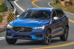 Picture of a driving 2019 Volvo XC60 T6 AWD in Bursting Blue Metallic from a front left perspective