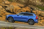Picture of a driving 2019 Volvo XC60 T6 AWD in Bursting Blue Metallic from a left side perspective