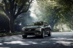 Picture of a driving 2019 Volvo XC60 T6 AWD in Pine Gray Metallic from a front left perspective